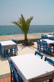 Traditional Greek table at the beach Stock Image