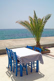Traditional Greek table at the beach Stock Images