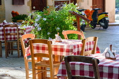 Traditional Greek tables at cafe on Crete island Royalty Free Stock Photos