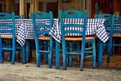 Traditional greek tavern. With blue wooden chairs Stock Photography