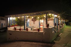 Traditional Greek tavern at night in Parikia on the island of Paros, Cyclades. Greece europe home christianity european white sunny landmark flag typical royalty free stock photo