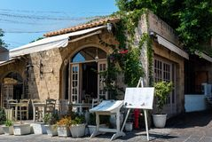 Traditional Greek tavern in Rhodes town on Rhodes island, Greece Royalty Free Stock Photo