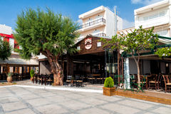 Traditional Greek tavernas at promenade of Sitia town on Crete island, Greece. SITIA, CRETE, GREECE - JUNE 2016: Traditional Greek tavernas at promenade of Sitia stock photos