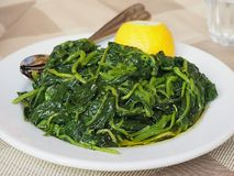 Traditional Greek Village Greens or Horta. A typical vegetable dish in Greek cooking called Horta, boiled greens royalty free stock photos