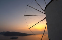 Traditional greek village, Oia, Santorini, sunset with winmill Royalty Free Stock Photo