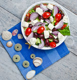 Traditional Greek village salad. On wooden background stock photography