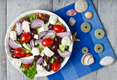 Traditional Greek village salad. On wooden background stock photo