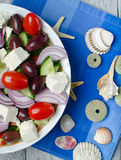 Traditional Greek village salad. On wooden background royalty free stock photo