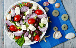 Traditional Greek village salad. On wooden background royalty free stock images