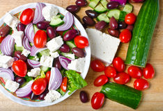 Traditional Greek village salad. On wooden background royalty free stock photography
