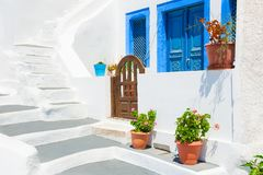 Traditional greek white architecture on Santorini island, Greece. Traditional greek white architecture with blue doors and windows. Santorini island, Greece stock image