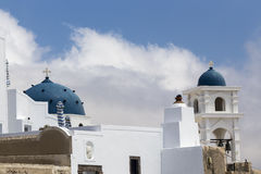 Traditional Greek white church arch with cross and bells in Sant Royalty Free Stock Photos