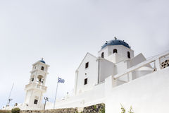 Traditional Greek white church arch with cross and bells in Sant. Orini Greece Stock Photo