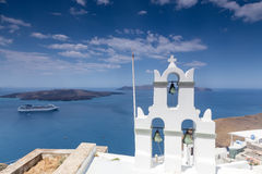 Traditional Greek white church arch with cross and bells in vill. Age Fira of Cyclades Island Santorini Greece Royalty Free Stock Images