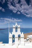 Traditional Greek white church arch with cross and bells in vill. Age Fira of Cyclades Island Santorini Greece Stock Photos