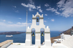 Traditional Greek white church arch with cross and bells in vill. Age Fira of Cyclades Island Santorini Greece Stock Photography