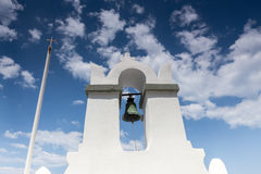 Traditional Greek white church arch with cross and bells in vill. Age Fira of Cyclades Island Santorini Greece. Close up Royalty Free Stock Photography