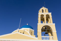 Traditional Greek white church arch with cross and bells in vill Royalty Free Stock Photography