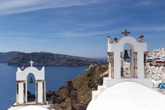 Traditional Greek white church arch with cross and bells in vill. Age Oia of Cyclades Island Santorini Greece Stock Photography