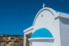 Traditional white church with blue roof. Agioi Anargyroi, Cyprus. Traditional Greek white church with a blue roof on the seaside. Agioi Anargyroi orthodox Royalty Free Stock Image