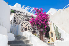 Traditional Greek whitewashed stone house, Santorini island, Greece. Stock Photos