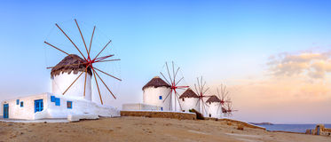 Traditional greek windmills on Mykonos island, Cyclades, Greece. Panoramic view of traditional greek windmills on Mykonos island at sunrise, Cyclades, Greece royalty free stock photos
