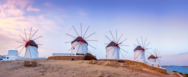 Traditional greek windmills on Mykonos island, Cyclades, Greece. Panoramic view of traditional greek windmills on Mykonos island at sunrise, Cyclades, Greece stock photography