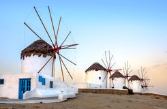 Traditional greek windmills on Mykonos island at sunrise, Cyclad Stock Photography