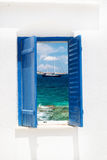 Traditional greek window on Sifnos island Stock Photos