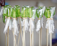 Traditional green candy on stick. Traditional green coloured stick candy in a rural store stock images