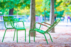 Traditional green chairs in the Tuileries garden in Paris, France Royalty Free Stock Photography