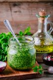 Traditional green chimichurri sauce with fresh parsley, red onion, garlic, olive oil in glass Royalty Free Stock Image