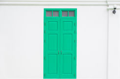 traditional green door wooden of an old on white wall Royalty Free Stock Image