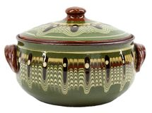 Traditional green glazed clay pot Stock Image