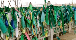 Traditional green ribbons on the fence of muslim stock video