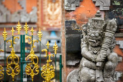 Traditional guard statue carved in stone in front of the gate of Royalty Free Stock Photo