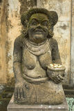 Traditional guard statue carved in stone on Indonesia. Architecture. Royalty Free Stock Images