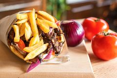 Greek Gyros pita with fresh salad ingredients stock images