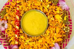 Traditional Haldi turmeric kept on a flower plate for the hindu marriage ceremony royalty free stock images