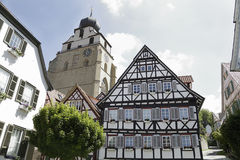 Traditional half-timbered houses. And the church Stiftskirche located in Herrenberg, Black Forest, Baden-Wurtemberg, Germany Stock Image