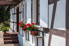 Traditional half-timbered houses in the streets of Hunspach in Alsace, France Stock Photos