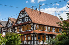 Traditional half-timbered houses in the streets of Hunspach in Alsace, France Royalty Free Stock Photos