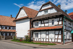 Traditional half-timbered houses in the streets of Hunspach, Alsace royalty free stock photos