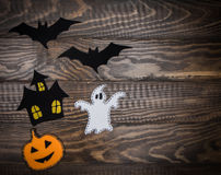 Traditional Halloween characters made of felt and velvet paper on the wooden background Royalty Free Stock Image