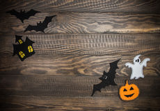 Traditional Halloween characters made of felt. Wooden background. Halloween handmade. Stock Photography