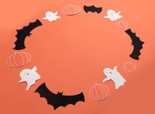 Frame of haloween symbols on red background for logo and text stock photography