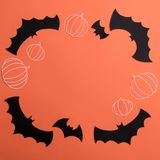 Frame of haloween symbols on red background for logo and text. Traditional haloween symbols of black bats and pumpkins on red background. Haloween picture and Stock Photography