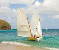 Traditional hand-built dinghies competing in an annual race in the windward islands Royalty Free Stock Image