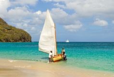 A traditional hand-built dinghy competing in an annual race in the windward islands Royalty Free Stock Photography