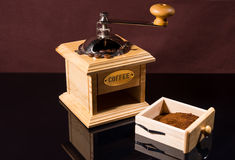 Traditional Hand Grinder with Fresh Ground Coffee Royalty Free Stock Image